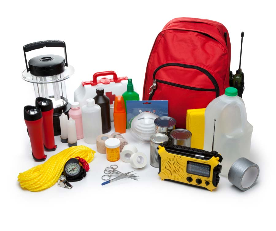 various emergency supplies such as flashlights, rope, compass, medical supplies, radio, food, water, tape and backpack