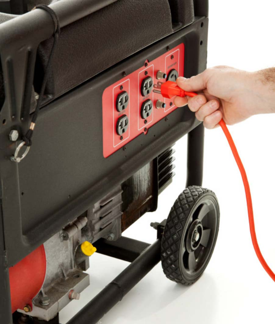 Hand plugging in cord to generator