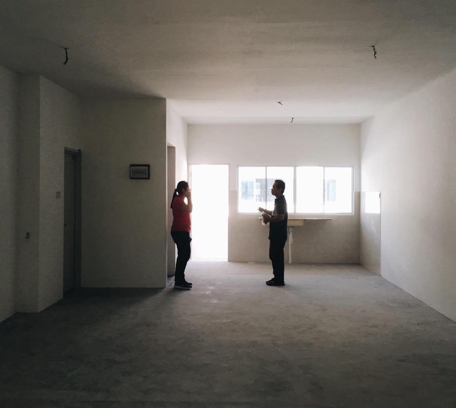 Woman and man in an empty apartment