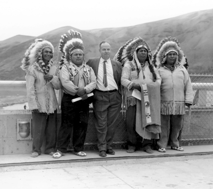 Historical black and white photo of Wanapum in regalia standing with a man in a business suit.