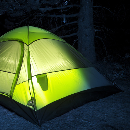 Camp tent with glowing light inside