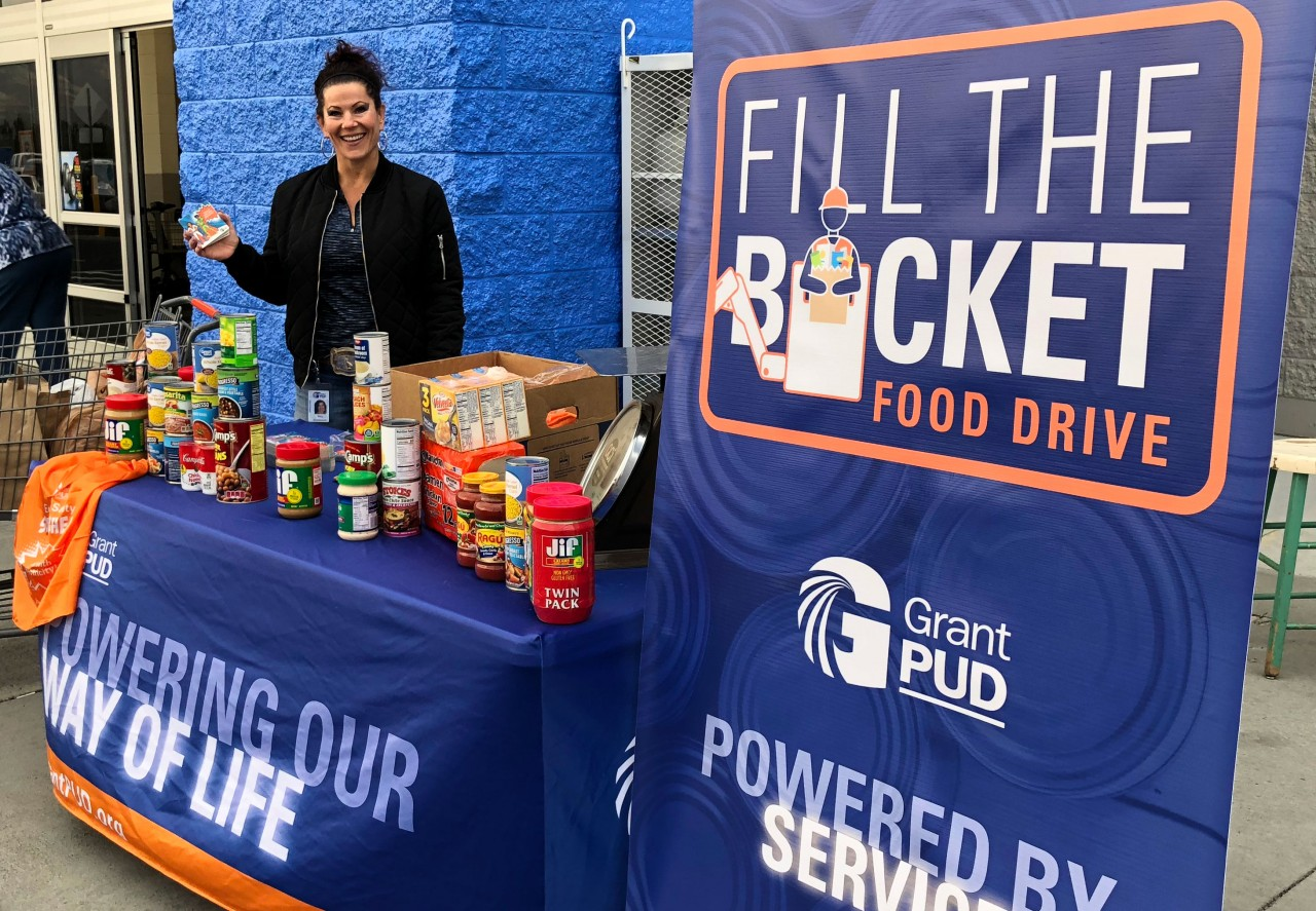 Grant PUD employee collecting food at the Fill the Bucket food drive.