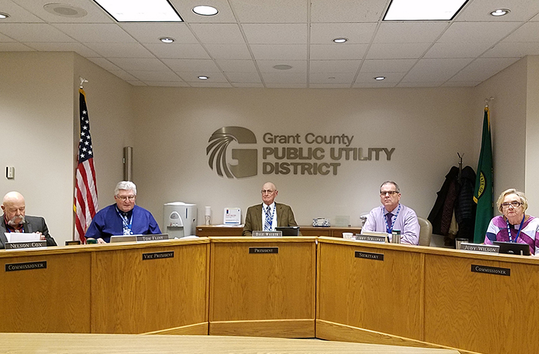 All five commissioners talking during a meeting